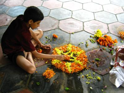 Preparing Pookalam for Onam