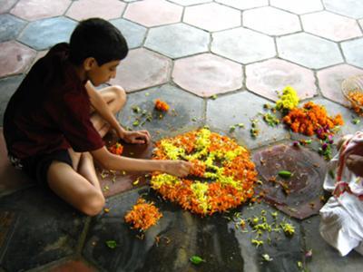 Preparing Pookalam for Onam
